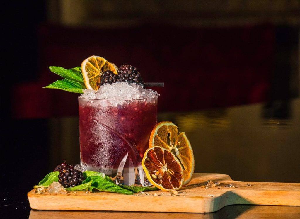 blackberry cocktail garnished with fresh fruit
