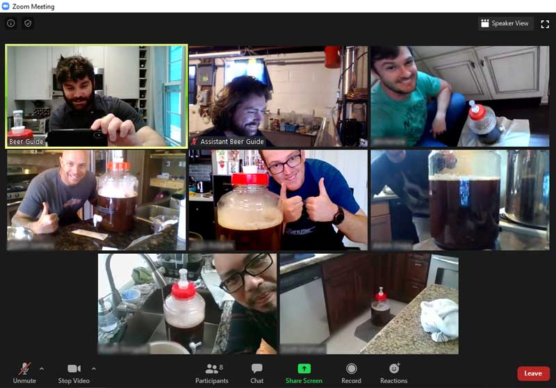 people via videoconference stand with homebrew in fermentors
