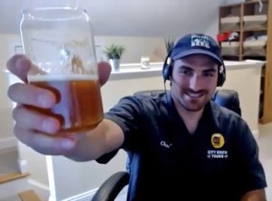 guy holding beer to camera
