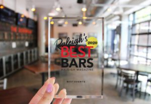Clouds displaying their award for Raleigh's best bar 2020